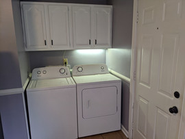 Laundry in the kitchen with additional storage