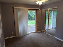 Sliding door for patio / back yard access and additional closet space