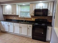Updated kitchen with brand new granite countertops