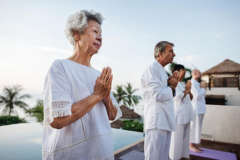 group-of-seniors-practicing-yoga-by-the-