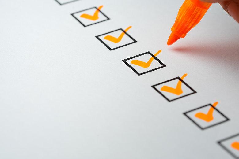 Orange marking on checklist box with pen, Checklist concept.jpg
