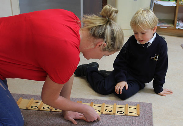 Teacher Hayley Fitzpatrick works with a young student