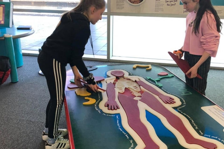"Two Wicklow Montessori students get hand-on experience playing ""Operation"""