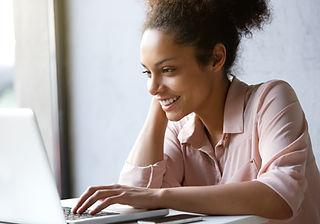 gorgeous black girl on her computer.jpg