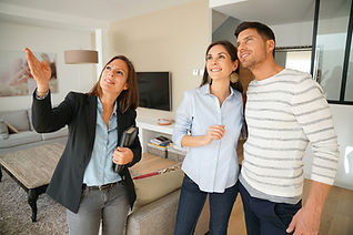 Real Estate Agent Showing Property to a