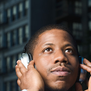 Canva - Man Listening to Headphones.jpg