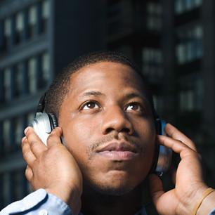 Canva - Man Listening to Headphones.jpg