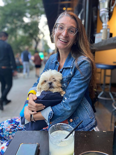 A woman holding her dog adopted via Waggytail Rescue