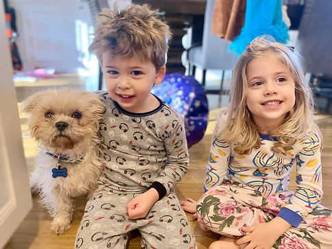 a portrait of two children with their newly adopted dog from Waggytail Rescue
