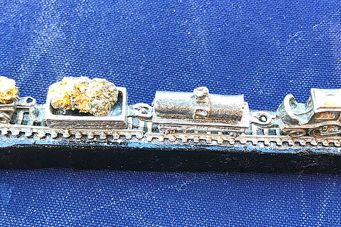 Gold train on real railroad spike
