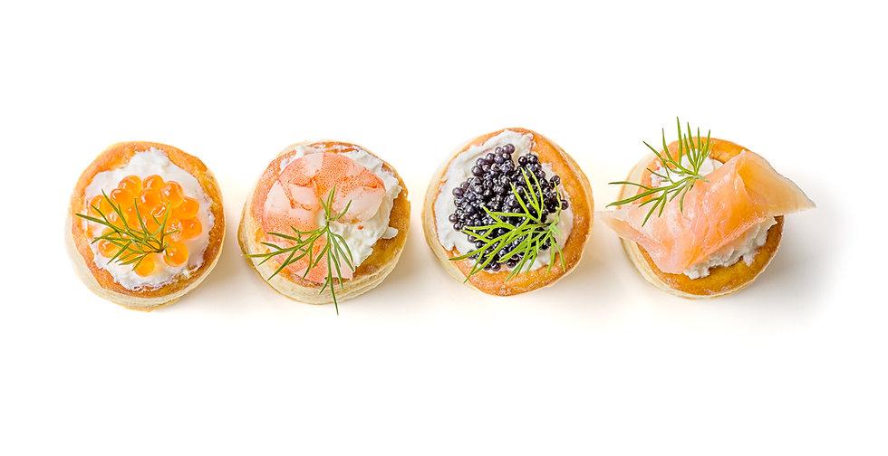 Pastries with salmon, caviar and shrimp.