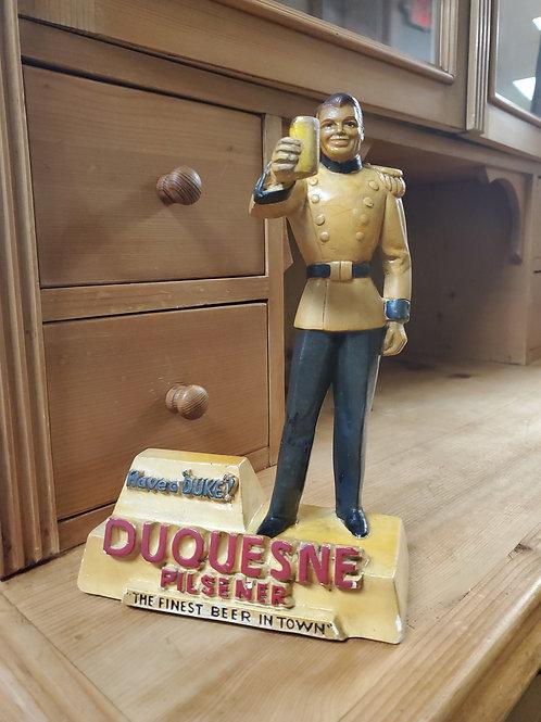 """Duquesne Pilsner Figurine titled 'Have a """"Duke""""!"""