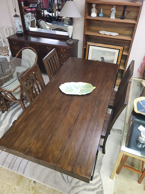 Dark Wood Dining Room Table With A Set Of 4 Chairs