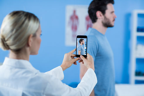 physiotherapist-clicking-photo-male-patient (1).jpg