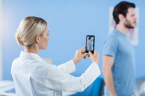 physiotherapist-clicking-photo-male-patient.jpg