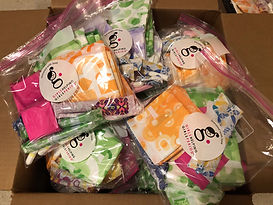 Packs of pads and tampons to donate