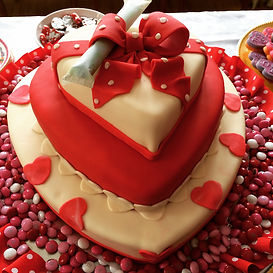 Red heart cake with tampon topper to celebrate a Valentines Day fundraiser
