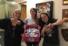 Indiana Univ. sorority sisters show off some of the items they collected in houses on campus