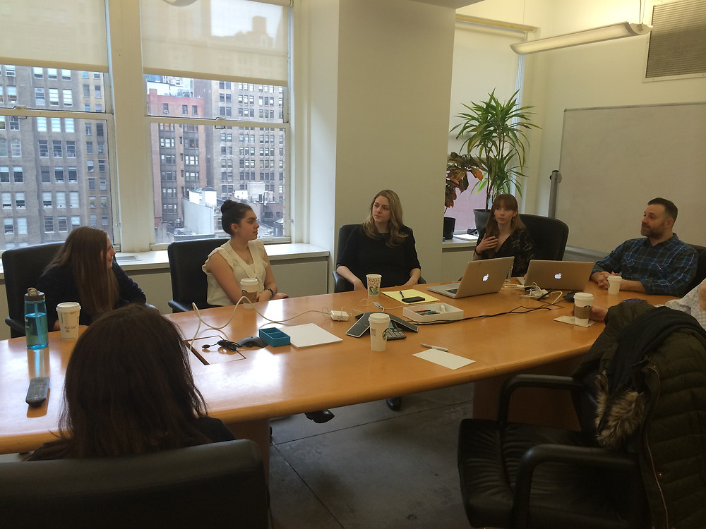 The girls around a conference table at CultHealth ad agency