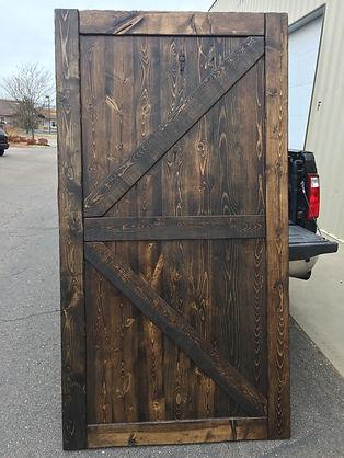 Full Paneled Barn Door Stained Dark Walnut
