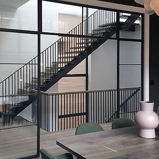 Winchester Residence with Custom Fabricated Stairs and Railings by Bader Art Metal Refined Metal Fabrication