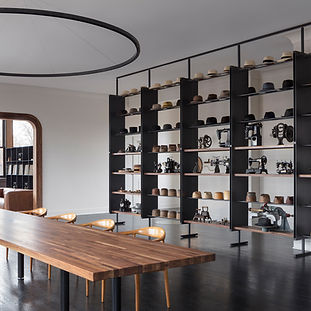 Award-Winning design at Optimo Hat Company featuring custom fabricated diplays, shelving, workbenches and more by Bader Art Metal Refined Metal Fabrication