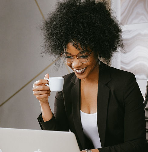 woman-in-black-blazer-holding-white-ceramic-mug-3727455_edited_edited.jpg