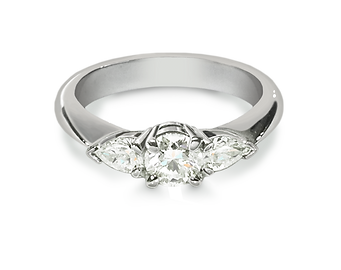 A Luxury 3 stone diamond engagment ring made in Palladium 950, Has a 0.34ct round brilliant cut diamond surrounded on either side by a pear cut diamond. Designed and made by Steven Anderson Jewellers