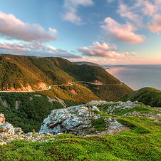 The winding road of the Cabot Trail overlooking the Atlantic Ocean in Nova Scotia Canada. Plan my trip to Nova Scotia