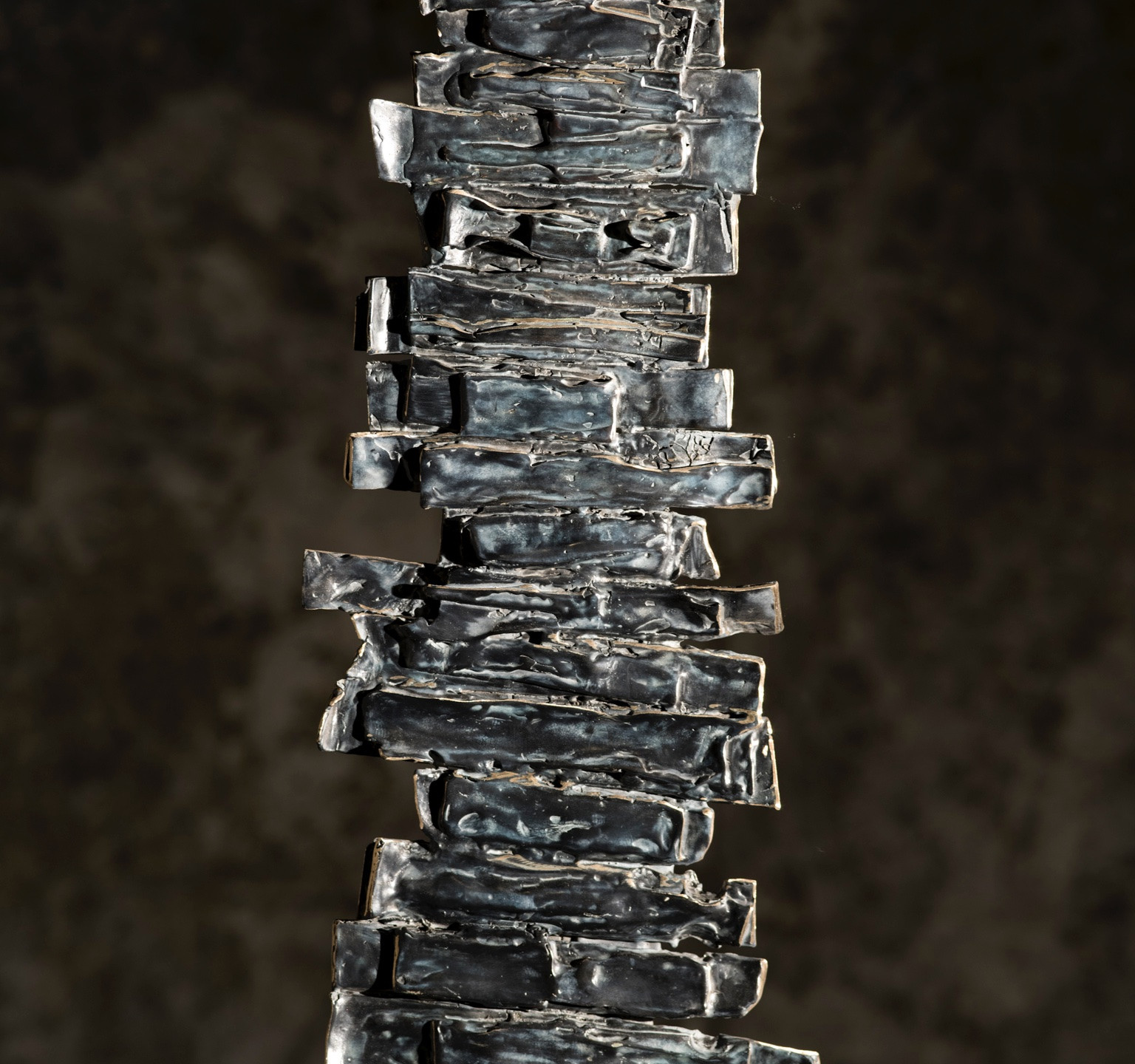 """Entière"" Bronze on polished steel stand, 21x7 in."
