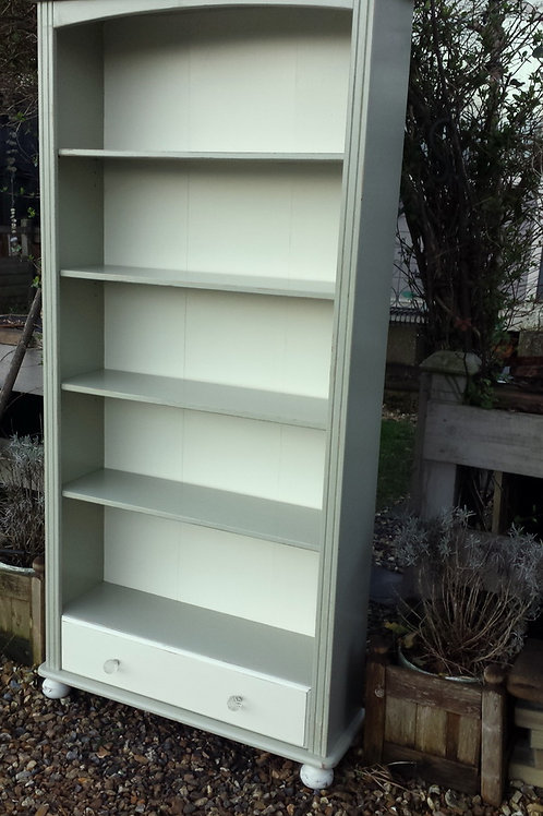 Painted bookcase with drawer.