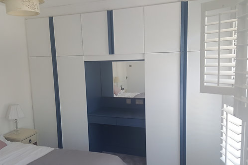 Fitted Wardrobes in Navy and White.