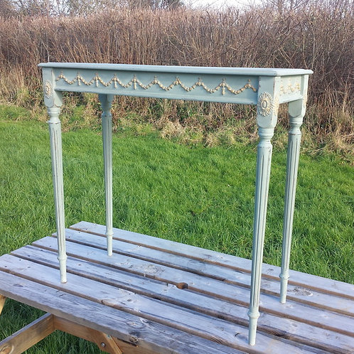 Ornate console table with gold detail.