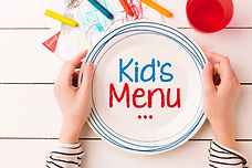Plate with 'Kid's Menu' sign in child's
