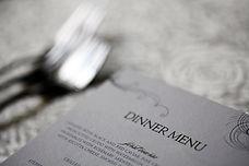 Close up shot of a dinner menu on a tabl