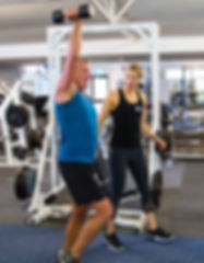 Personal trainer carrying out a weight training sessions