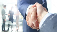stock-photo-closeup-of-a-business-handsh