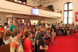 sanctuary pews filled with kids from camp.jpg