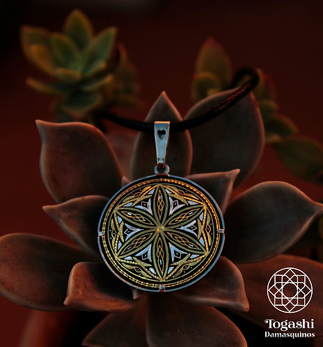 Damascene handmade pendant made of 24 kt pure gold and silver.