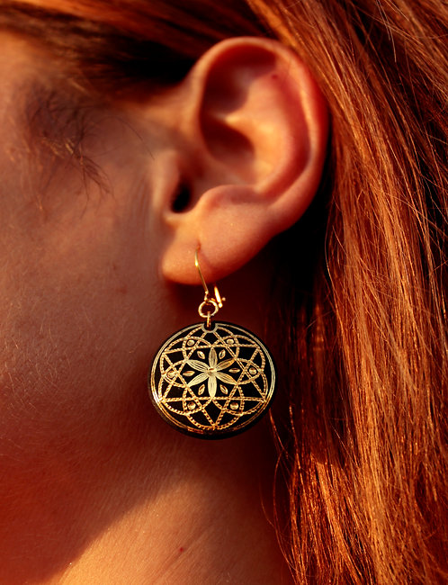 Damascene handmade earrings made with 24 kt pure gold .