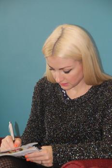 Kate Miller-Heidke writing down her inspiration and ideas