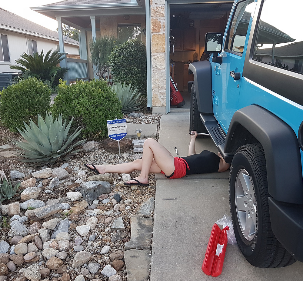 Me installing my running boards