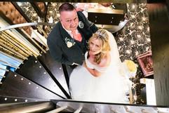 Bride & Groom Gaze Up from Spiral Staircase. Torrance Hotel.jpg