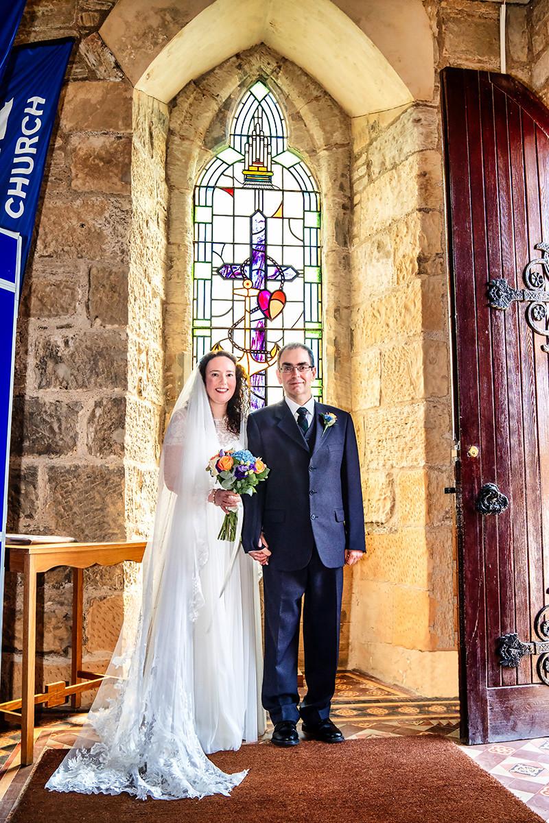 The Bride & Groom Pose in Lenzie Old Parish Church