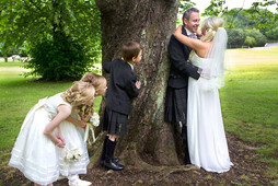 Bride & Groom Gaze Into Each Others Eyes, Kids Take a Peek. Eastwood Park, Glasgow