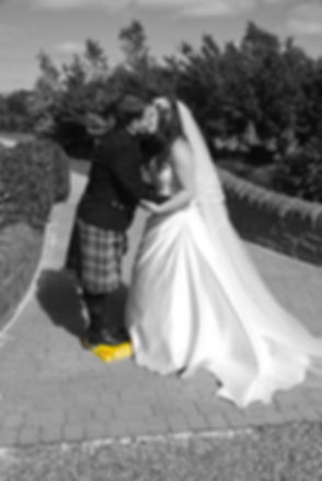 The Groom Stands on a Book to Kiss His New Wife, Lochside House Hotel