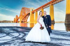 Bride & Groom Pose Beside the Forth Rail Bridge.