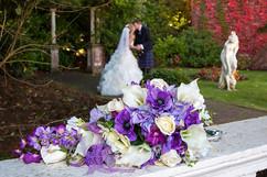 Bouquet in Foreground, Bride & Groom in Background, Bothwell Bridge Hotel
