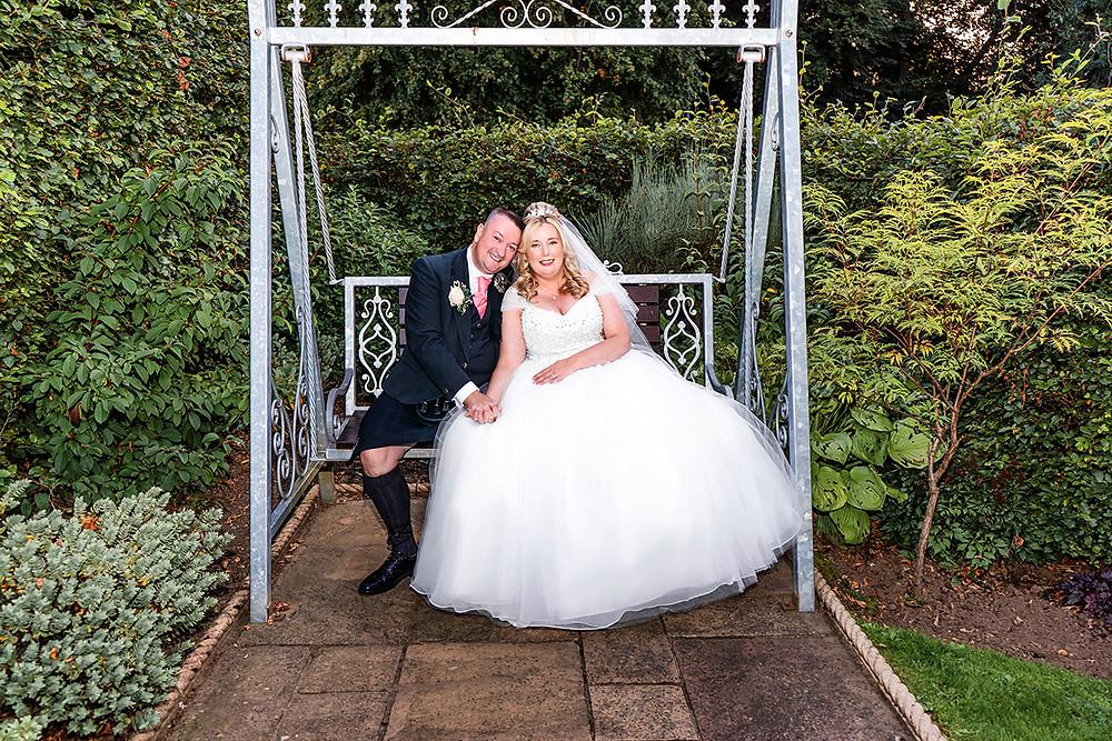Bride & Groom Hug on the Swing, Torrance Hotel