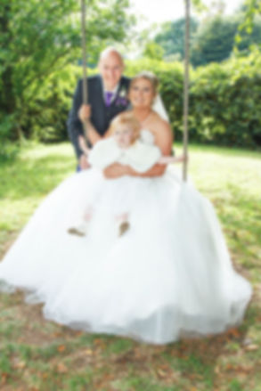 Bride, Groom & Little Daughter on a Swing, Balbirnie House Hotel